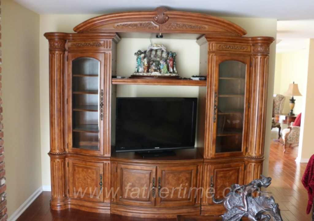 Father Time Auctions, Entertainment cabinet with 5 separate sections. Beautifully crafted with rich hard woods / burled wood doors / beveled glass door inserts and bronze antique style hardware.